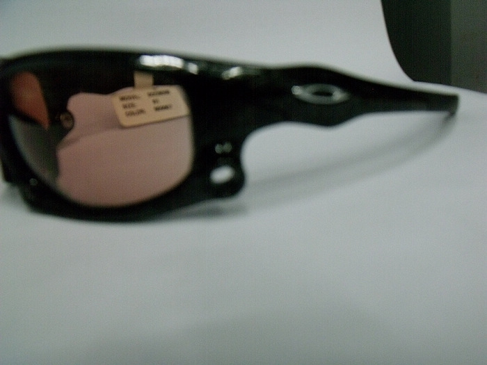 white and black oakley sunglasses  sunglasses   1900
