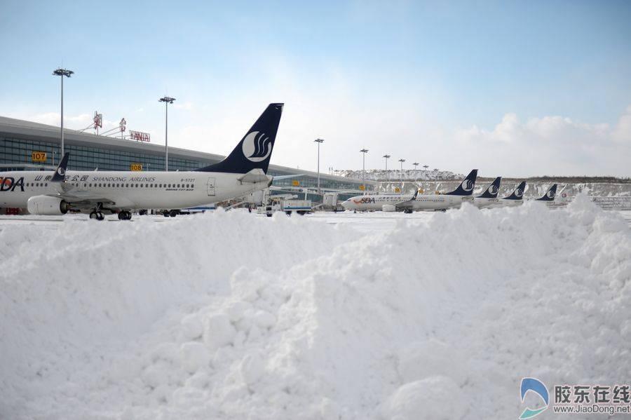 来看看雪中的烟台新机场吧!